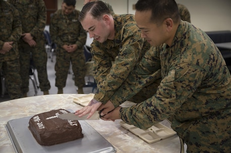 Chief Hospital Corpsman (Fleet Marine Force) Edgar E. Cuenca, right, a preventive medicine technician with Command Element, III Marine Expeditionary Force, and Hospital Corpsman (FMF) Joseph E. Clack, left, a corpsman assigned to 3rd Medical Battalion, 3rd Marine Logistics Group, III MEF, simultaneously cut a ceremonial cake during a celebration for the 119th birthday of the hospital corpsman rate at Camp Mujuk, Pohang, Republic of Korea, June 17, 2017. Marines from Bravo Company, 3rd Law Enforcement Battalion, III Marine Headquarters Group, III MEF and Corpsmen with 3rd Med Bn, 3rd MLG, III MEF came together to celebrate the birthday with a ceremonial cake cutting and birthday message reading from 3rd LE Bn senior enlisted advisor 1st Sgt. Derrick Benbow. (U.S. Marine Corps photo by Lance Cpl. Andy Martinez)