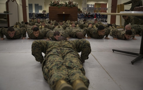 1st Sgt. Derrick Benbow, senior enlisted advisor of 3rd Law Enforcement Battalion, III Marine Headquarters Group, III Marine Expeditionary Force, alongside Marines and Corpsmen conduct pushups during the 119th Hospital Corpsman Birthday at Camp Mujuk, Pohang, Republic of Korea, June 17, 2017. Marines from Bravo Company, 3rd LE Bn, III MHG, III MEF and Corpsmen with 3rd Medical Battalion, 3rd Marine Logistics Group, III MEF came together to celebrate the birthday with a ceremonial cake cutting and birthday message reading from 3rd LE Bn senior enlisted advisor. (U.S. Marine Corps photo by Lance Cpl. Andy Martinez)