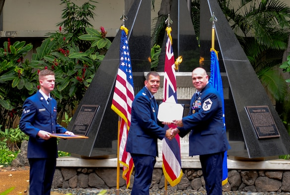 Col. Steven Dickerson, 557th Weather Wing commander, presents Senior Master Sgt. Jason L. Ronsse, 17th Operational Weather Squadron superintendent, with a Purple Heart Medal at the Hall of Heroes, on Joint Base Pearl Harbor-Hickam, Hawaii, June 20, 2017. Ronsse received numerous injuries in Dec. 2013 during his deployment in Bagram, Afghanistan in support of Operation Enduring Freedom. (U.S. Air Force photo by Airman 1st Class Jacoya Scandrick)