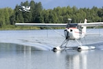 An Elmendorf Aero Club Cessna 172 float plane taxis in while a Cessna 185 takes off at Six-Mile Lake, Alaska. The Elmendorf Aero Club is the only Air Force Aero Club that offers float planes.(U.S. Air Force photo/Airman Jack Sanders)