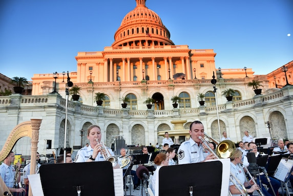 Here, husband and wife team, MSgt and TSgt Rosengaft perform a duet with the band at the Capitol steps on a lovely evening during the band's summer concert series. (U.S. Air Force photos/CMSgt Kamholz/released)