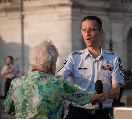 Senior Master Sgt. Matthew Irish dancing with an enthusiastic audience member during their program, R.O.C.K. in the USA! at the United States Capitol.