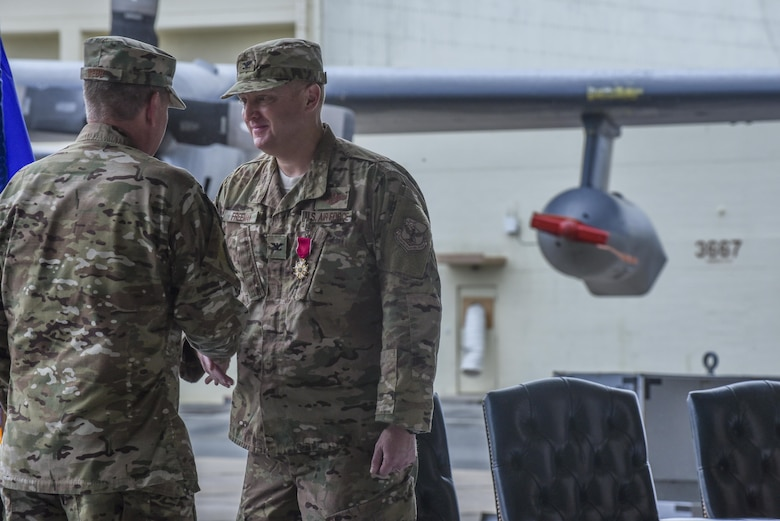 U.S. Air Force Lt. Gen. Brad Webb, commander of Air Force Special Operations Command, shakes hands with U.S. Air Force Col. William Freeman, outgoing commander of the 353rd Special Operations Group, and thanks Freeman for his leadership to the 353rd SOG during a change of command ceremony, June 19, 2017 at Kadena Air Base, Japan. Freeman leaves Kadena for an assignment at AFSOC Headquarters at Hurlburt Field, Fla. (U.S. Air Force photo by Senior Airman Nicholas Emerick)