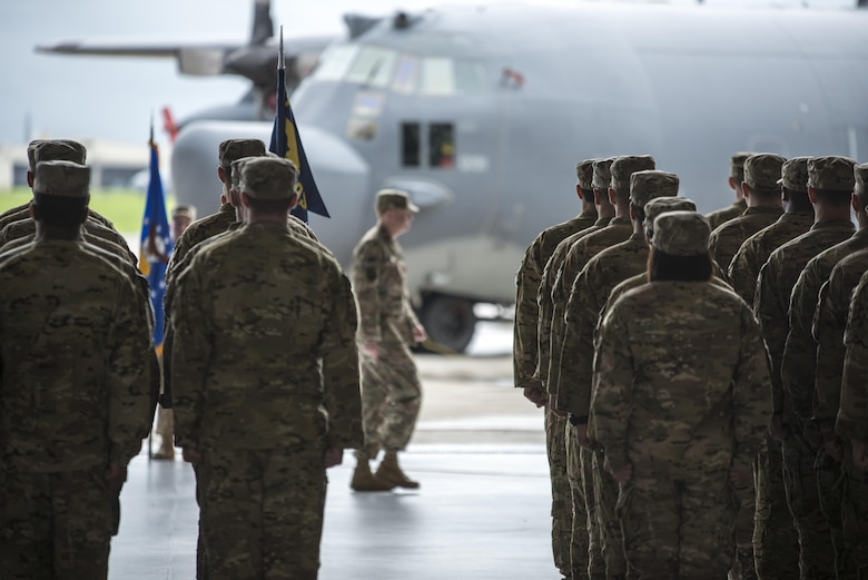 U.S. Air Force Col. William Freeman, outgoing commander of the 353rd Special Operations Group, walks off the stage following conclusion of the 353rd SOG change of command ceremony, June 19, 2017 at Kadena Air Base, Japan. Freeman leaves Kadena for an assignment at AFSOC Headquarters at Hurlburt Field, Fla. (U.S. Air Force photo by Capt. Jessica Tait)