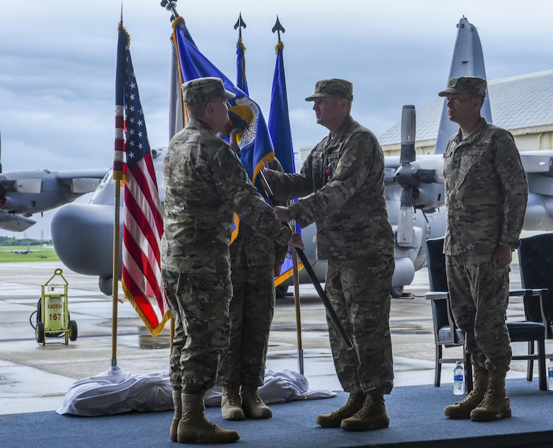U.S. Air Force Col. William Freeman, outgoing commander of the 353rd Special Operations Group, symbolically passes the guidon to U.S. Air Force Lt. Gen. Brad Webb, commander of Air Force Special Operations Command, to signify the end of his command during a change of command ceremony, June 19, 2017 at Kadena Air Base, Japan. The ceremony is a time-honored tradition in which one officer relinquishes command and passes it to another. (U.S. Air Force photo by Senior Airman Nicholas Emerick)