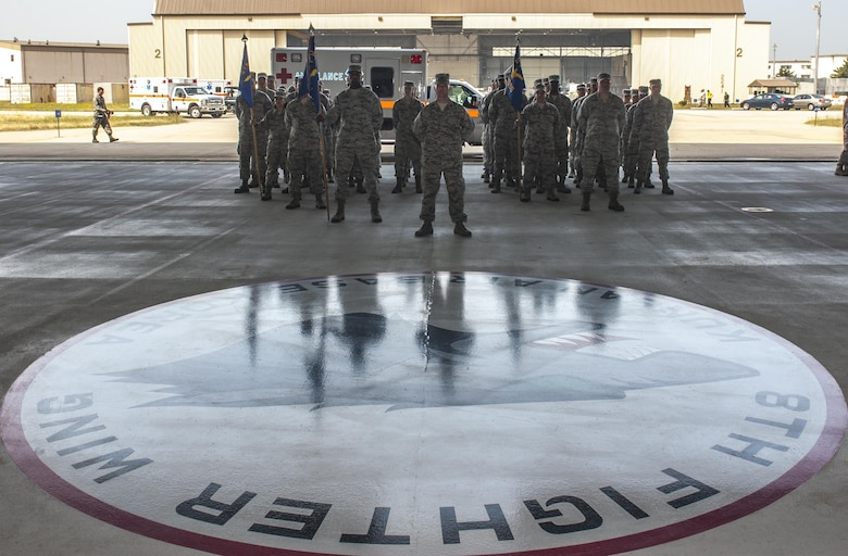 "U.S. Airmen from the 8th Medical Group stand in formation during a change of command ceremony at Kunsan Air Base, Republic of Korea, June 23, 2017. Col. Joann V. Palmer took command of the 8th MDG from Col. Lisa A. Davison and upon assuming the position, received the title of ""Hawk."" (U.S. Air Force photo by Senior Airman Colville McFee/Released)"