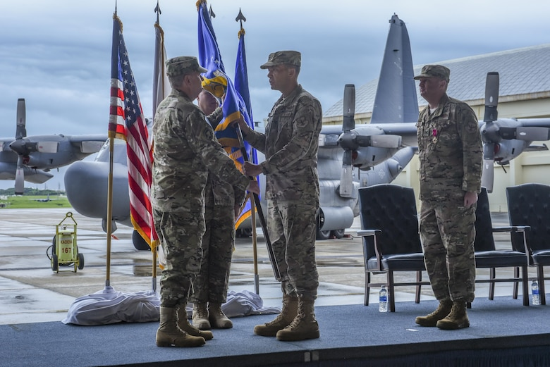 U.S. Air Force Lt. Gen. Brad Webb, commander of Air Force Special Operations Command, symbolically passes the guidon to U.S. Air Force Col. Jason Kirby, incoming commander of the 353rd Special Operations Group, to signify the beginning of his command during a change of command ceremony, June 19, 2017 at Kadena Air Base, Japan. The ceremony is a time-honored tradition in which one officer relinquishes command and passes it to another. (U.S. Air Force photo by Senior Airman Nicholas Emerick)