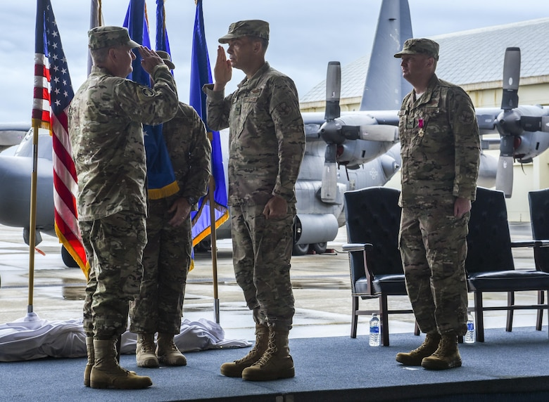 U.S. Air Force Lt. Gen. Brad Webb, commander of Air Force Special Operations Command, symbolically passes the guidon to U.S. Air Force Col. Jason Kirby, incoming commander of the 353rd Special Operations Group to signify the beginning of his command during a change of command ceremony, June 19, 2017 at Kadena Air Base, Japan. The ceremony is a time-honored tradition in which one officer relinquishes command and passes it to another. (U.S. Air Force photo by Senior Airman Nicholas Emerick)