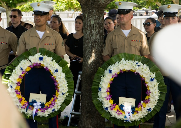 U.S. Marines stand by to place wreaths on the Cornerstone of Peace during the 2017 Okinawa Memorial Day services June 23, 2017 at Peace Memorial Park, Itoman, Japan. Service members and Okinawan residents came together to place wreaths as a tribute to all who lost their lives in the Battle of Okinawa. During the ceremony all who attended stood for a moment of silence honoring those that gave the ultimate sacrifice for their country. (U.S. Marine Corps photo by Lance Cpl. Charles Plouffe)