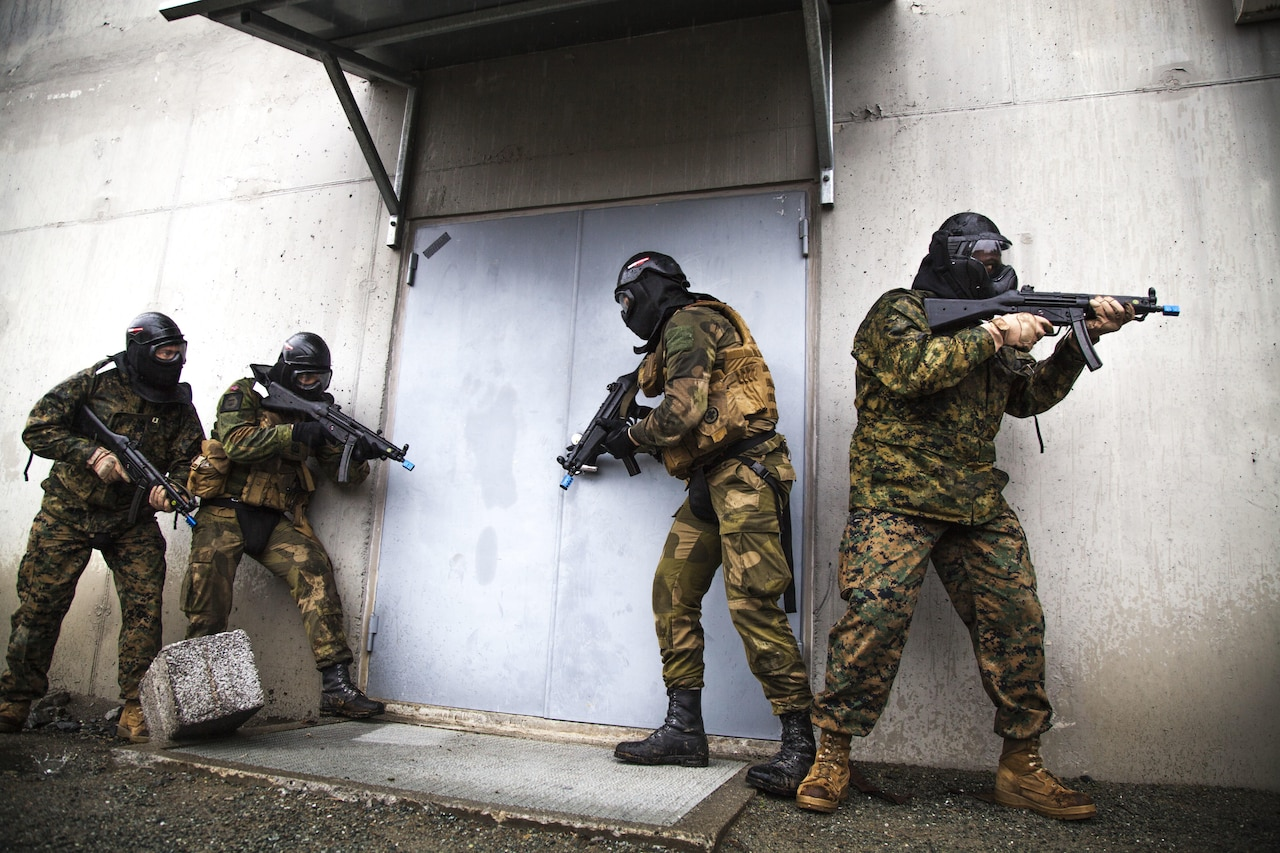 U.S. Marines and sailors with Marine Rotational Force 17.1 and soldiers with Norwegian Home Guard 12 prepare to enter a building during a room-clearing exercise near Stjordal, Norway, May 24, 2017. This exercise compared the standard operating procedures for Marines and Norwegian forces in the event of an active shooter or hostage negotiation. Marine Corps photo by Cpl. Emily Dorumsgaard