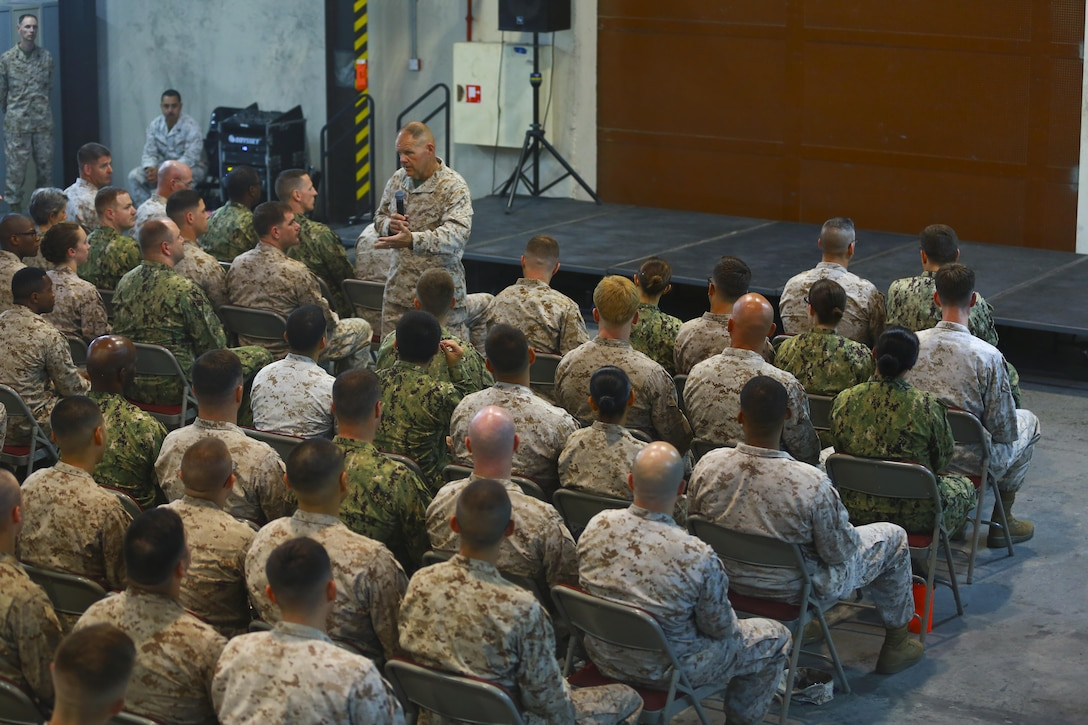 Commandant of the Marine Corps, Gen. Robert B. Neller speaks to the Marines and Sailors with Naval Amphibious Forces, Task Force 51/5th Marine Expeditionary Brigade (TF 51/5) during a town-hall meeting aboard Naval Support Activity Bahrain, June 21. During the town-hall, Neller discussed updated social media guidance, his expectation that Marines will treat each other with dignity and respect, as well as, the importance of naval integration. (U.S. Marine Corps photo by Cpl. Travis Jordan/Released)
