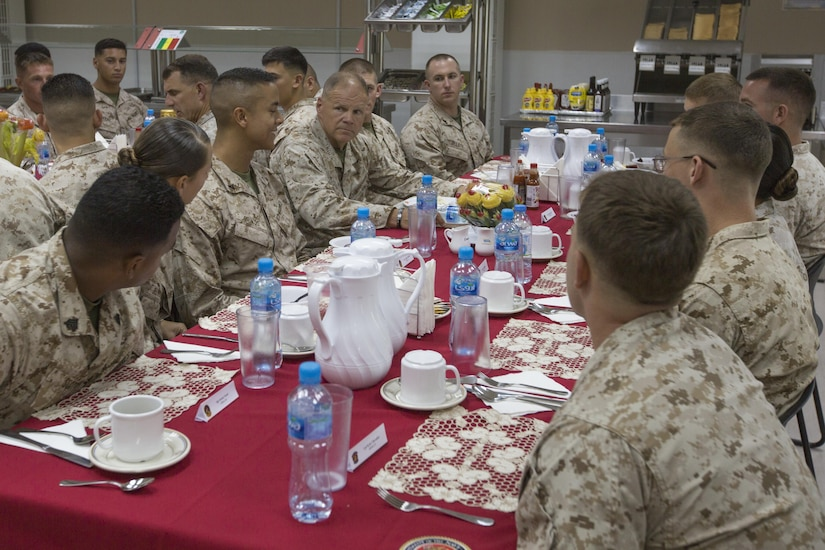Commandant of the Marine Corps Gen. Robert B. Neller eats lunch with U.S. Marines with Special Purpose Marine Air Ground Task Force Crisis Response Central Command in the Fifth Fleet area of operations, June 21, 2017. Neller visited to speak with Marines about the current state of the Corps and answer their questions. (U.S. Marine Corps photo by Cpl. Samantha K. Braun)
