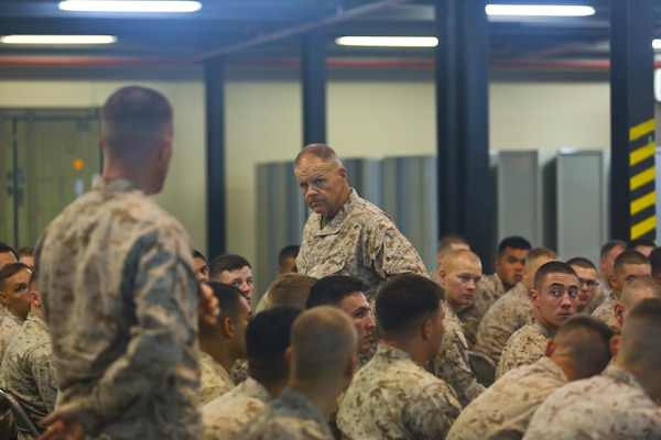 Commandant of the Marine Corps, Gen. Robert B. Neller listens to a question from a Marine with the Fleet Anti-Terrorism Security Team Central Command (FASTCENT) during a town-hall meeting aboard Naval Support Activity Bahrain, June 21. During the town-hall, Neller discussed updated social media guidance, his expectation that Marines will treat each other with dignity and respect, as well as, the importance of naval integration. (U.S. Marine Corps photo by Cpl. Travis Jordan/Released)