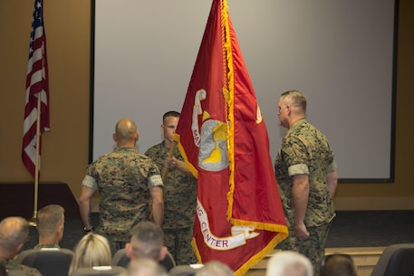 U.S. Marine Col. Brett Bourne, commanding officer, Marine Raider Training Center, with Master Gunnery Sgt. Jerome Root, MRTC senior enlisted advisor,  uncase the new MRTC colors during a redesignation ceremony aboard Marine Corps Base Camp Lejeune, N.C., June 21, 2017. The Marine Special Operations School was redesignated as the Marine Raider Training Center, reactivating the unit for the first time since the original Marine Raiders were disbanded in 1944. (Marine Corps photo by Sgt. Scott Achtemeier)