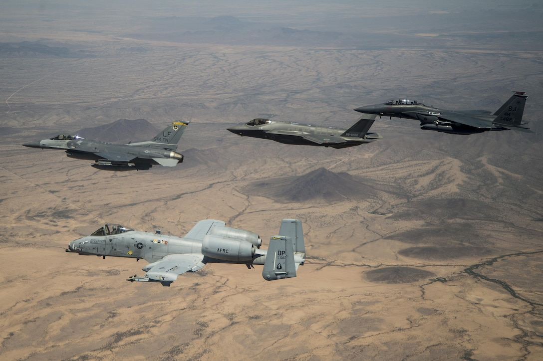 Col. Kurt Gallegos, the 944th Fighter Wing commander, leads a four-ship formation with the A-10 Thunderbolt II, F-35 Joint Strike Fighter and F-15 Strike Eagle, during his fini-flight near Luke Air Force Base, Ariz., June 2, 2017. Gallegos, a career F-16 Fighting Falcon pilot with more than 4,100 hours, was the first F-16 pilot to drop bombs in Afghanistan after the September 11, 2001 attacks. His fini-flight marks the end of a 32-year Air Force career. (U.S. Air Force photo/Tech. Sgt. Larry E. Reid Jr.)