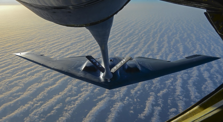 A KC-135 Stratotanker assigned to the 100th Air Refueling Wing Royal Air Force Mildenhall, England, prepares to transfer fuel to a B-2 Spirit from Whiteman Air Force Base, Mo., off the coast of Spain, June 13, 2017. Two B-2s deployed to the U.K. to participate in theater bomber assurance and deterrence operations. Bomber deployments enhance the readiness and training necessary to respond to any contingency or challenge across the globe. (U.S. Air Force photo/Staff Sgt. Micaiah Anthony)