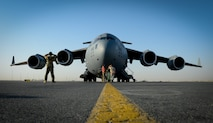 Airman 1st Class Sagan Fisher, an 816th Expeditionary Airlift Squadron C-17 Globemaster III loadmaster, and maintainers from the 8th Expeditionary Mobility Squadron, perform a C-17 pre-departure check before a mission in support of Operation Inherent Resolve, June 14, 2017, at Al Udeid Air Base, Qatar. The C-17 is capable of rapid strategic delivery of troops and all types of cargo to bases throughout the Central Command area of responsibility. The aircraft can be outfitted to perform tactical airlift, airdrop, and aeromedical evacuation as missions require. (U.S. Air Force photo/ Staff Sgt. Michael Battles)