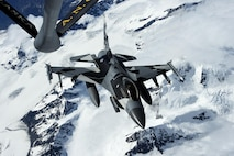 An F-16 Fighting Falcon assigned to the 18th Aggressor Squadron, refuels from a KC-135 Stratotanker assigned to the 168th Air Refueling Wing, during Red Flag-Alaska 17-2 June 14, 2017, at Eielson Air Force Base, Alaska. Red Flag-Alaska provides an optimal training environment in the Indo-Asia Pacific Region and focuses on improving ground, space, and cyberspace combat readiness and interoperability for U.S. and international forces. (U.S. Air Force photo/Staff Sgt. Paul Labbe)