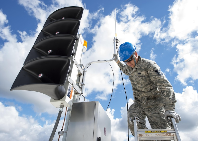Airmen assigned to the 210th Engineering Installation Squadron add an antenna to a newly installed Giant Voice stack located on the roof of the Small Air Terminal at the 133rd Airlift Wing in St. Paul, Minn., June 19, 2017. Once complete, the system will provide improved emergency notification capabilities to flight line and maintenance personnel while aircraft engines are running. Strobes will also light up on top of the stack as an added visual durning alerts.    (U.S. Air National Guard photo/Tech. Sgt. Austen R. Adriaens)