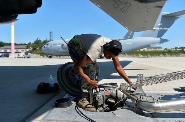 U.S. Air Force Airman 1st Class Justin Burr, 86th Logistics Readiness Squadron fuels operator, hooks up a hydrant coupler on Ramstein Air Base, Germany, June 20, 2017. The 86th Logistics Readiness Squadron's petroleum, oils, and lubricants flight is responsible for handling the installation's military fuel supply. (U.S. Air Force photo by Airman 1st Class Joshua Magbanua)