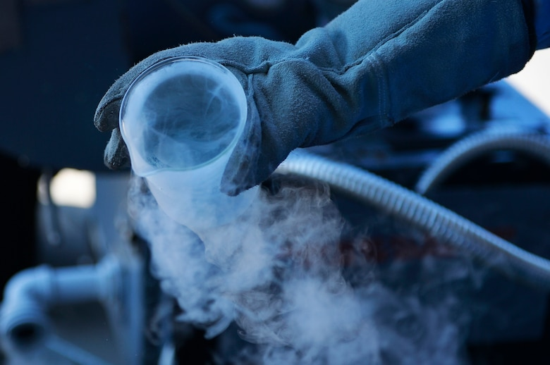 U.S. Air Force Staff Sgt. Matthew Richards, 86th Logistics Readiness Squadron fuels supervisor, holds a beaker filled with liquid oxygen on Ramstein Air Base, Germany, June 20, 2017. Liquid oxygen is breathed in by pilots flying in high altitudes. (U.S. Air Force photo by Airman 1st Class Joshua Magbanua)