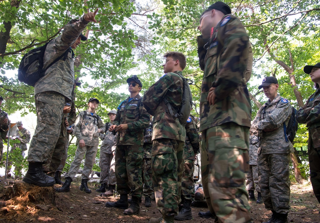 Civil Air Patrol Major Walter Brown, Royal Air Force Mildenhall Cadet Squadron deputy commander, instructs CAP European Encampment cadets on Ramstein Air Base, Germany, June 21, 2017. The cadets had many challenges to overcome from learning proper dress, drill and ceremony to figuring out how to communicate as they carried out challenges like the woodland obstacle course. These challenges are designed to transform American youth into leaders and build knowledge of aerospace throughout the U.S. population. (U.S. Air Force photo by Senior Airman Elizabeth Baker)