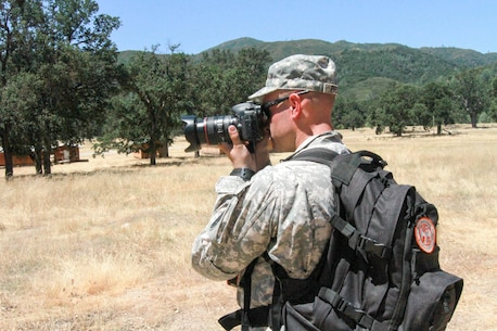U.S. Army Reserve Capt. Troy Preston makes a photograph during a situational training exercise at Fort Hunter Liggett, Calif. June 17, 2017 while participating in Exercise News Day. The purpose of Exercise News Day is to provide Public Affairs (PA) Soldiers and units with an opportunity to practice their craft in a real-world training environment, improve individual technical skills, and reinforce Mission Essential Task List training while providing PA support for 90% of the Army Reserve's summer annual training exercises. U.S. Army photo by Capt. Patrick Cook.