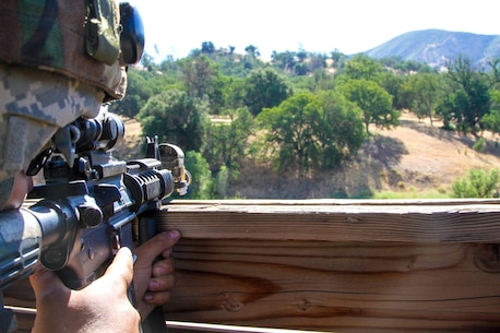 U.S. Army Reserve Spc. Antonio Garcia of the 341st Military Police Company, 200th Military Police Command, observers his sector of fire during WAREX 17-03 at Fort Hunter Liggett, Calif., on June 19, 2017. More than 3000 U.S. Army Reserve soldiers are participating in the 84th Training Command's Warrior Exercise (WAREX) 19-17-03 at Fort Hunter Liggett, Calif.; the WAREX is a large-scale collective training platform to generate capable, lethal and combat ready forces. U.S. Army photo by Capt. Troy Preston.