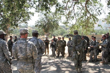 U.S. Army Reserve Sgt. David Tedrow, an Observer-Coach-Trainer with the 91st Training Division, 84th Training Command, conducts an after action review with the 341st Military Police Company, 200th Military Police Command after a base defense exercise as part of WAREX 17-03 at Fort Hunter Liggett, Calif., June 19, 2017. More than 3000 U.S. Army Reserve soldiers are participating in the 84th Training Command's Warrior Exercise (WAREX) 19-17-03 at Fort Hunter Liggett, Calif.; the WAREX is a large-scale collective training platform to generate capable, lethal and combat ready forces. U.S.Army photo by Capt. Troy Preston.