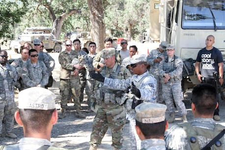 Observer-Coach-Trainers with the 91st Training Division, 84th Training Command, conduct an after action review with the 341st Military Police Company, 200th Military Police Command after a base defense exercise as part of WAREX 17-03 at Fort Hunter Liggett, Calif., June 19, 2017. More than 3000 U.S. Army Reserve soldiers are participating in the 84th Training Command's Warrior Exercise (WAREX) 19-17-03 at Fort Hunter Liggett, Calif.; the WAREX is a large-scale collective training platform to generate capable, lethal and combat ready forces. U.S.Army photo by Capt. Troy Preston.