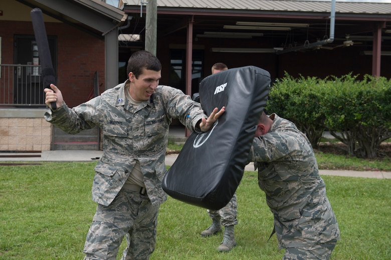 Cadet Sean Murphy, University of Miami Detachment 155, swings a baton during combative training as part of Operation Air Force, June 14, 2017, at Moody Air Force Base, Ga. The annual event is designed to give cadets a hands-on training experience and a glance at various mission assets at bases across the world. The program allows cadets to confirm or reassess their pursued career fields while learning different support functions to become better leaders of Airmen in the future. (U.S. Air Force photo by Senior Airman Greg Nash)