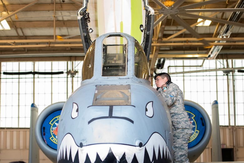 Cadet Leoncio Longoria, University of Texas at San Antonio Detachment 842,examines the cockpit of an A-10C Thunderbolt II as part of Operation Air Force 2017, June 16, 2017, at Moody Air Force Base, Ga. The annual event is designed to give cadets a hands-on training experience and a glance at various mission assets at bases across the world. The program allows cadets to confirm or reassess their pursued career fields while learning different support functions to become better leaders of Airmen in the future. (U.S. Air Force photo by Senior Airman Greg Nash)