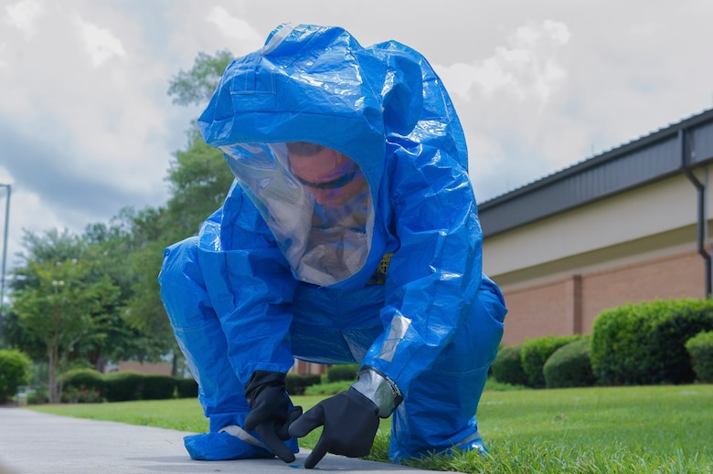 Cadet William Dell, Florida State Detachment 145, picks up hazardous biological material during a simulated exercise as a part of Operation Air Force, June 19, 2017, at Moody Air Force Base, Ga. The annual event is designed to give cadets a hands-on training experience and a glance at various mission assets at bases across the world. The program allows cadets to confirm or reassess their pursued career fields while learning different support functions to become better leaders of Airmen in the future. (U.S. Air Force photo by Senior Airman Greg Nash)