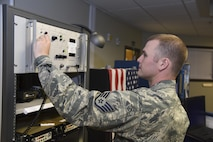 Staff Sgt. Dean Chambers works with equipment in the command post at the 117th Air Refueling Wing June 15, 2017 in Birmingham, Alabama.  Dean, a recent distinguished graduate of technical training at Keesler Air Force Base in Biloxi, Mississippi, is a command and control specialist. (U.S. Air National Guard photo by: Airman 1st Class Lee Murphy)