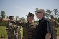The Deputy Secretary of Defense, Honorable Mr. Robert O. Work, right, speaks with Lt. Col. Theodore Bethea, commanding officer of Advanced Infantry Training Battalion-East, School of Infantry- East, at Camp Lejeune, N.C., June 2, 2017. Marines from the School of Infantry demonstrated a live fire exercise as a part of training to diplomats and military personnel during their visit to the base.  (U.S. Marine Corps photo by Lance Cpl. Tyler Pender)