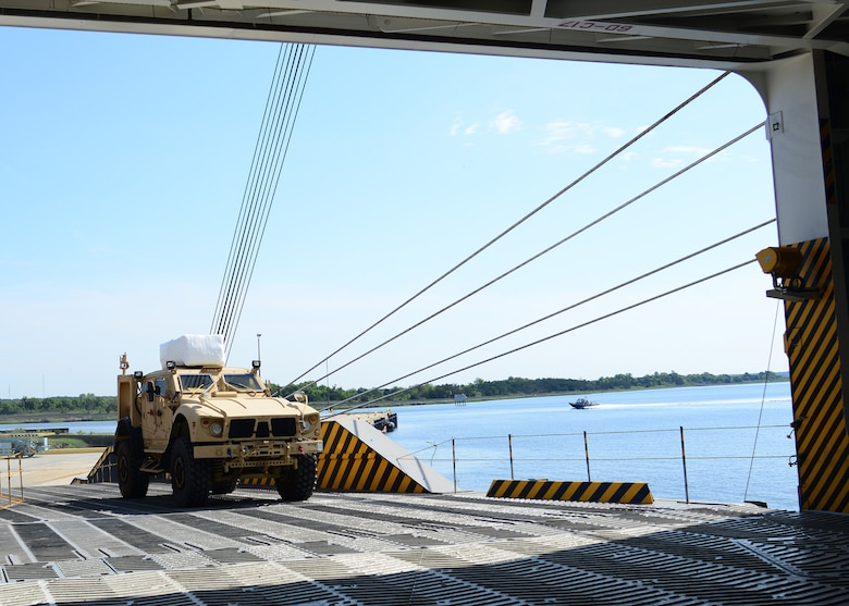 A Mine-Resistant Ambush Protected vehicle is on-loaded onto the Liberty Maritime Corporation's ship Liberty Passion at Joint Base Charleston, S.C., June 15, 2017. Members from the 841st Transportation Battalion staged, processed and configured the equipment in support of Marine Corps pre-positioning and staging across Europe and Asia. The 841st TB conducts surface distribution and port clearance operations in support of Geographic Combatant Commanders and deployment readiness.