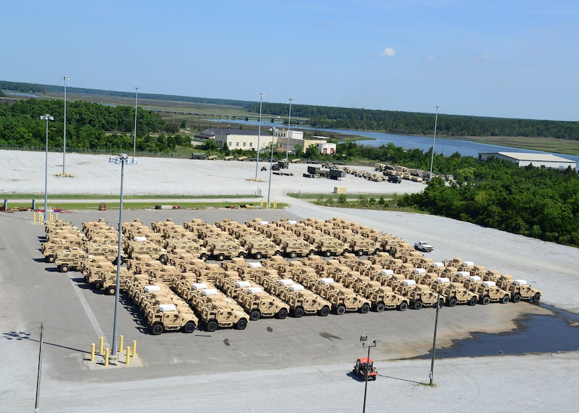Mine-Resistant Ambush Protected vehicles are prepared to be on-loaded onto the Liberty Maritime Corporation's ship Liberty Passion at Joint Base Charleston, S.C., June 15, 2017. Members from the 841st Transportation Battalion staged, processed and configured the equipment in support of Marine Corps pre-positioning and staging across Europe and Asia. The 841st TB conducts surface distribution and port clearance operations in support of Geographic Combatant Commanders and deployment readiness.