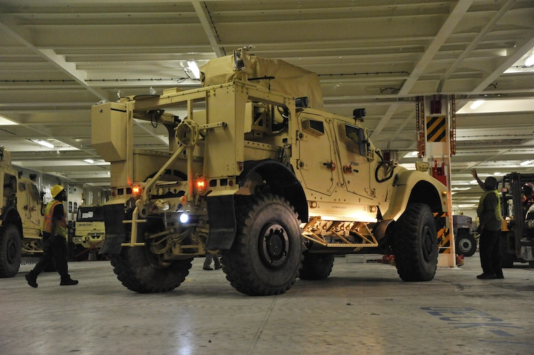 Civilians and U.S. Army Soldiers assigned to the 841st Transportation Battalion on-load Mine-Resistant Ambush Protected vehicles onto the Liberty Maritime Corporation's ship Liberty Passion at Joint Base Charleston, S.C., June 15, 2017. Members from the 841st TB staged, processed and configured the equipment in support of Marine Corps pre-positioning and staging across Europe and Asia. The 841st TB conducts surface distribution and port clearance operations in support of Geographic Combatant Commanders and deployment readiness.