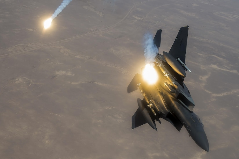An Air Force F-15E Strike Eagle fires flares during a flight supporting Operation Inherent Resolve, June 21, 2017. Air Force photo by Staff Sgt. Trevor T. McBride