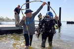 Petty Officer 1st Class Kyle Johnson, a Sector New York Engineering Detachment member, finishes a helmet dive during a community project called Warriors with Disabilities at Coast Guard Station Sandy Hook, June 1, 2017. Monmouth County Sheriff's Maritime Emergency Response Team and the Handicapped Scuba Diving Alliance partnered with the Coast Guard and various local agencies, creating a joint team uniting the skills and experiences of Military Veterans with first responders to train for emergency responses. Coast Guard photo by Petty Officer 1st Class Sabrina Clarke.