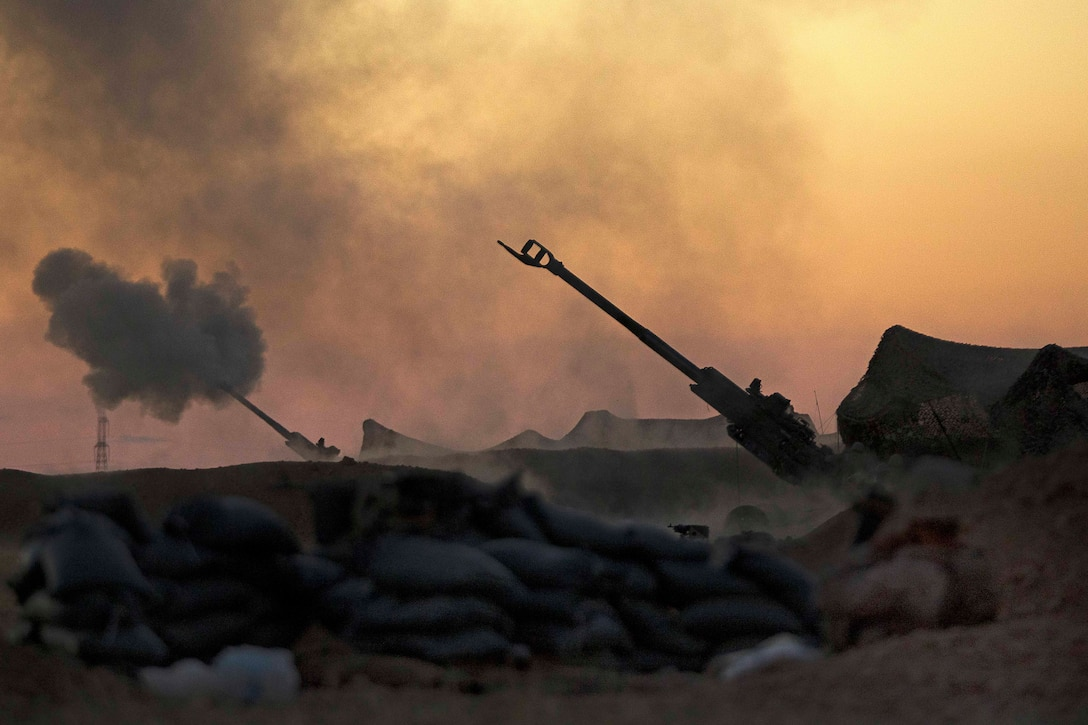 Marines fire an M777A2 howitzer in the early morning in Syria, June 2, 2017. Marines have been conducting 24-hour all-weather fire support for the coalition's local partners, the Syrian Democratic Forces, to support Combined Joint Task Force Operation Inherent Resolve. Marine Corps photo by Sgt. Matthew Callahan