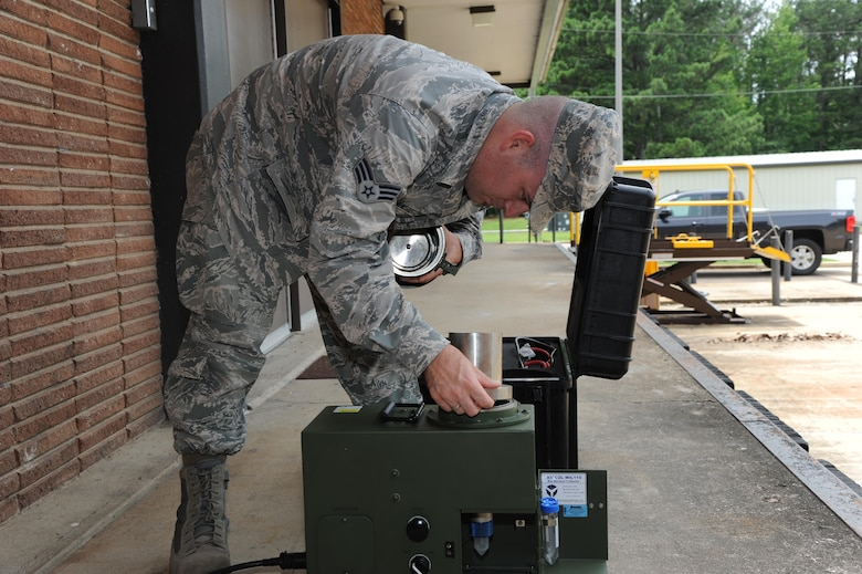 Senior Airman Kevin Morgan, 14th Medical Operations Squadron Bioenvironmental Technician, assembles an XMX machine June 20, 2017, at Columbus Air Force Base, Mississippi. The XMX is a vacuum that takes in air and runs it through water which can then be tested for chemicals and biological material. (U.S. Air Force photo by Airman 1st Class Beaux Hebert)