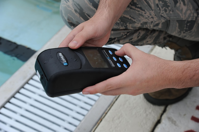Airman 1st Class Michael Mannarino, 14th Medical Operations Squadron Bioenvironmental Technician, uses a device to test the chlorine levels in the base pool June 21, 2017, at Columbus Air Force Base, Mississippi. Mannarino has to test different areas in the pool to come up with an average chlorine level. (U.S. Air Force photo by Airman 1st Class Beaux Hebert)