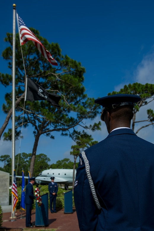 A member of the Hurlburt Field Honor Guard pays respects during the Operation Eagle Claw memorial ceremony at Hurlburt Field, Fla., June 23, 2017. Operation Eagle Claw was an attempted rescue mission on April 24, 1980, into Iran to liberate more than 50 American hostages captured after a group of radicals took over the American embassy in Tehran, Nov. 4, 1979. The mission resulted in the deaths of eight U.S. service members at a remote site deep in Iranian territory known as Desert One. The five Airmen who were killed were assigned to the 8th Special Operations Squadron. (U.S. Air Force photo by Staff Sgt. Victor J. Caputo)