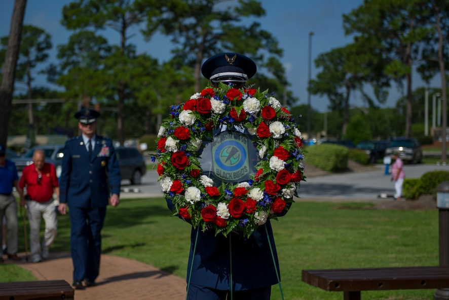 A member of the Hurlburt Field Honor Guard carries a wreath to the Operation Eagle Claw memorial ceremony at Hurlburt Field, Fla., June 23, 2017. Operation Eagle Claw was an attempted hostage-rescue mission in 1980 that resulted in five 8th Special Operations Squadron Airmen and three Marines sacrificing their lives when two of the involved aircraft collided at the Desert One staging site. (U.S. Air Force photo by Staff Sgt. Victor J. Caputo)