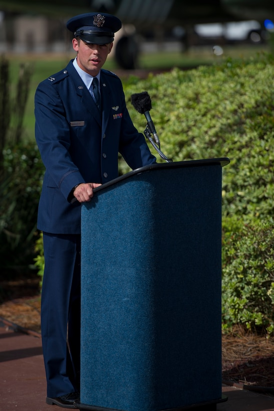 Capt. Mark Griffin, a pilot with the 8th Special Operations Squadron, narrates the Operation Eagle Claw memorial ceremony at Hulburt Field, Fla., June 23, 2017. Operation Eagle Claw was an attempted hostage-rescue mission in 1980 that resulted in five, 8th Special Operations Squadron Airmen and three Marines sacrificing their lives when two of the involved aircraft collided at the Desert One staging site. (U.S. Air Force photo by Staff Sgt. Victor J. Caputo)
