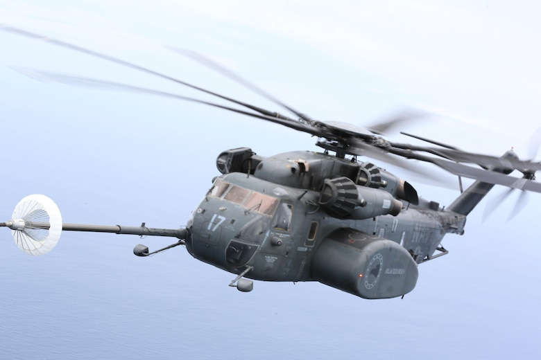 A U.S. Navy MH-53E Sea Dragon refuels during a joint training aerial refueling exercise near Marine Corps Air Station Cherry Point, N.C., June 21, 2017. A U.S. Marine Corps KC-130J Super Hercules assigned to Marine Aerial Refueler Transport Squadron 252, refueled four helicopters during the exercise. Joint training exercises such as this allow pilots to gain experience and improve unit readiness. The squadron is assigned to Marine Aircraft Group 14, 2nd Marine Aircraft Wing; and the four Navy aircraft are assigned to Helicopter Mine Countermeasures Squadron 14 and 15, Naval Air Force Atlantic, based at Naval Station Norfolk, Virginia. (U.S. Marine Corps photo by Pfc. Skyler Pumphret/ Released)