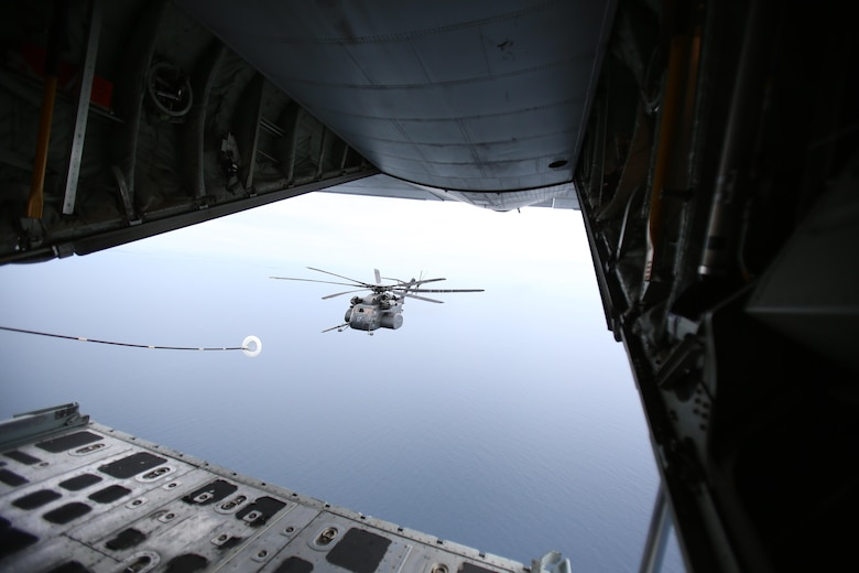 A U.S. Navy MH-53E Sea Dragon positions itself for refueling from a U.S. Marine Corps KC-130J Super Hercules during a joint refueling traning exericse near Marine Corps Air Station Cherry Point, N.C., June 21, 2017. Joint training exercises such as this allow pilots to gain experience and improve unit readiness. The KC-130J is assigned to Marine Aerial Refueler Transport Squadron 252, Marine Aircraft Group 14, 2nd Marine Aircraft Wing; and the Navy helicopter is from Helicopter Mine Countermeasures Squadron 14, Naval Air Force Atlantic, based at Naval Station Norfolk, Virginia. (U.S. Marine Corps Photo by Pfc. Skyler Pumphret/ Released)