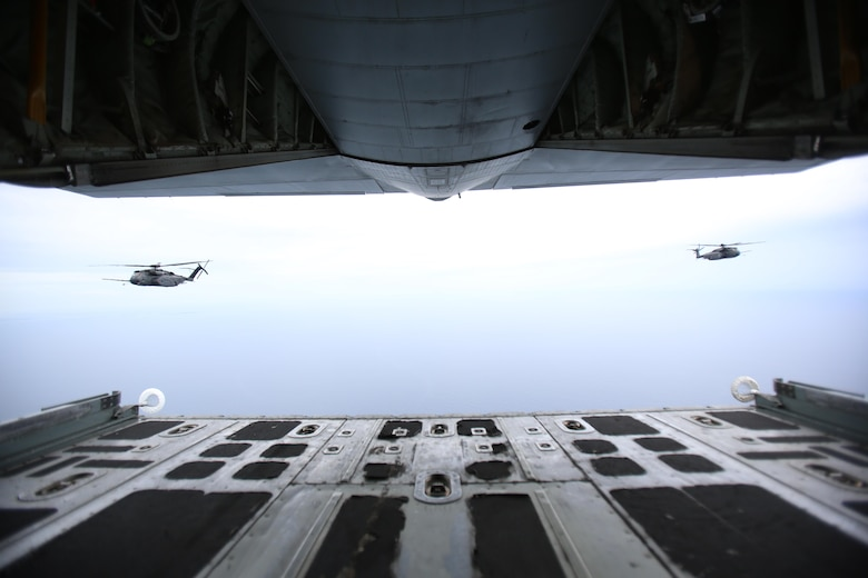 Two U.S. Navy MH-53E Sea Dragon helicopters follow a U.S. Marine Corps KC-130J Super Hercules during a joint aerial refueling exercise near Marine Corps Air Station Cherry Point, N.C., June 21, 2017. Joint training exercises such as this allow pilots to gain experience and improves unit readiness. The KC-130J is assigned to Marine Aerial Refueler Transport Squadron 252, Marine Aircraft Group 14, 2nd Marine Aircraft Wing; and the MH-53E's are with Helicopter Mine Countermeasures Squadron 14 and 15, Naval Air Force Atlantic, from Naval Station Norfolk, Virginia.(U.S. Marine Corps photo by Pfc. Skyler Pumphret/ Released)