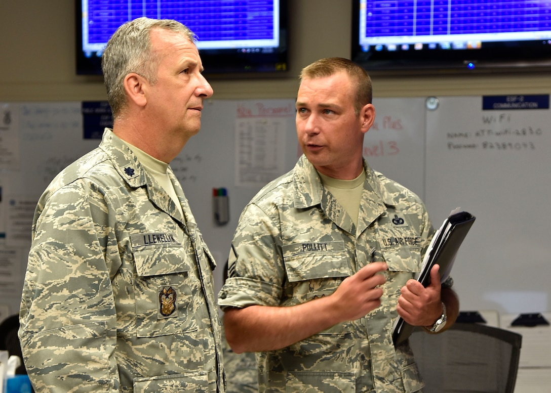 (From left) Air Force Lt. Col. Joseph J. Llewellyn, 175th inspector general, and Air Force Master Sgt. Curtis Pollitt, 175th Wing inspector general superintendent, discuss the accountability of the wing during an active shooter training exercise June 22, 2017, in the emergency operations center at Warfield Air National Guard Base, Middle River, Md. The base holds active shooter exercises twice annually and the EOC is set up throughout the year. (U.S. Air National Guard photo by Airman Sarah M. McClanahan)